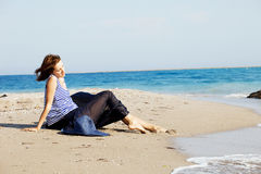 Beautiful  tanned woman resting on the beach in summer day Stock Photo