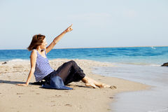 Beautiful  tanned woman resting on the beach in summer day Stock Photos
