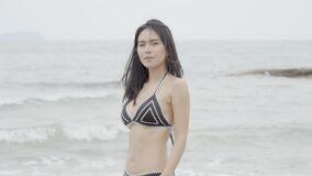Beautiful tanned young asian woman in bikini playful at the beach, girl sexy happy and smiling on summer travel in vacation