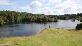 Beautiful Tarn Hows Lake District National Park England uk PAN. Tarn Hows Lake District National Park England uk on a beautiful sunny summer day popular with stock video