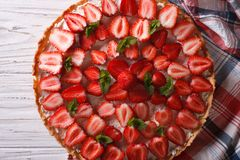 Beautiful tart with fresh strawberries close-up. horizontal top Stock Images