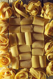 Beautiful tasty colorful pattern of italian pasta. Top view. Abs Stock Photos