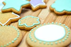 Cookies with icing. Beautiful and tasty festive cookies decorated with icing stock photography
