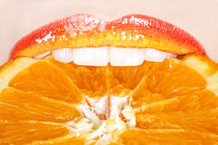 Beautiful and tasty orange lips Stock Images