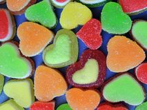 Colorful tasty jelly sweets hearts with sugar stock photos