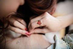A beautiful tatoo on woman's hand. The heart tatoo on the hand of a woman stock images