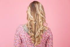 Beautiful tatooed woman wearing pink dress Royalty Free Stock Images