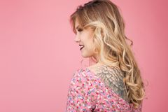 Beautiful tatooed woman wearing pink dress Stock Image