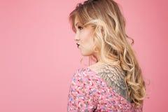 Beautiful tatooed woman wearing pink dress Royalty Free Stock Photography