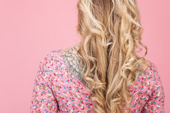 Beautiful tatooed woman wearing pink dress Royalty Free Stock Photos