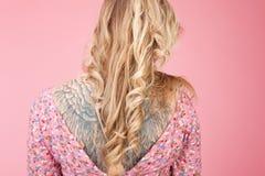 Beautiful tatooed woman wearing pink dress Stock Images