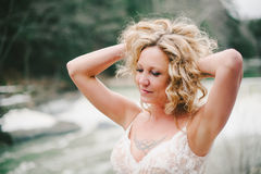 Beautiful Tattooed Blonde Woman with Hands in Hair Stock Photography