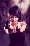 Beautiful tattooed girl with attitude holding gun Royalty Free Stock Photography