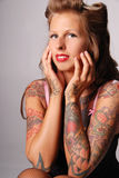 Beautiful tattooed woman. Royalty Free Stock Photo