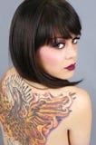 Beautiful tattooed woman. Beautiful woman with full back tattoo stock images