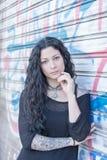 Beautiful tattooed woman urban style. Royalty Free Stock Image