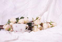 Beautiful tea set with white roses Stock Images