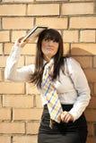 Beautiful teacher. My beautiful brunette teacher with book Royalty Free Stock Photo