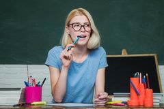 Beautiful teacher in classroom. Young teacher. Learning and education concept. Teacher in classroom. High school concept royalty free stock photo