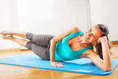 Beautiful teacher making fitness exercises with passion Royalty Free Stock Photos