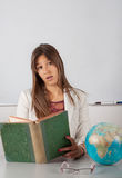 Beautiful teacher reading book Royalty Free Stock Photo