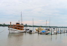 Beautiful, teakwood, luxury tour boat docked at a harbor with ot Stock Photography