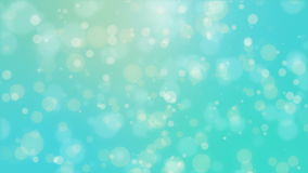 Beautiful teal blue glowing bokeh background. With floating light particles stock video footage