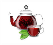 Beautiful teapot and cup with black tea Royalty Free Stock Photo