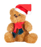 Beautiful teddy bear with scarf and Christmas hat. Isolated on white background stock photo