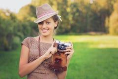 Beautiful teen age girl with retro camera royalty free stock photos