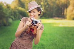 Beautiful teen age girl with retro camera royalty free stock photography