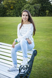 Beautiful teen on a bench Royalty Free Stock Photography