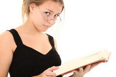 Beautiful Teen with Book. Beautiful 15 year old teenager with open book over white background Royalty Free Stock Image