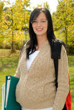 Beautiful Teen Girl. Beautiful Pregnant Teen School Girl Outdoors Ready To Go Back To School royalty free stock photo