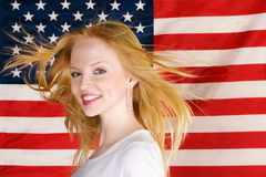 Beautiful teen girl against american flag Stock Image