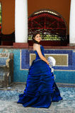 Beautiful teen girl. With an amazing blue dress posing in a old pool Stock Image