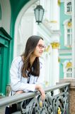 Beautiful teen girl on the background of ancient architecture royalty free stock photo