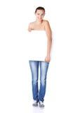 Beautiful teen girl behind big blank billboard Royalty Free Stock Photos