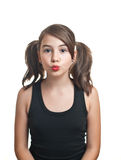 A beautiful teen girl in black top with pigtails . Portrait smiling girl with two pigtails Stock Photo
