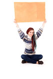 Beautiful teen girl with a blank corkboard Royalty Free Stock Photos