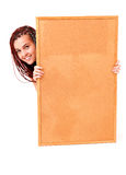 Beautiful teen girl with a blank corkboard Stock Photos