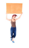 Beautiful teen girl with a blank corkboard Stock Photo