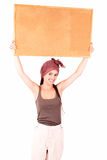 Beautiful teen girl with a blank corkboard Stock Images