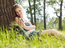 Beautiful teen girl in blue dress on the meadow stock photos