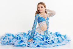 Beautiful teen girl in a blue suit oriental dance Royalty Free Stock Image