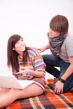 Beautiful teen girl and boy with computer Royalty Free Stock Photos