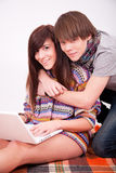 Beautiful teen girl and boy with computer Royalty Free Stock Photo