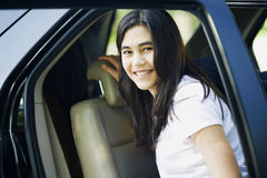 Beautiful teen girl by car door. Beautiful teen girl standing by her car door Stock Photos