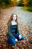 Beautiful teen girl in fall leaves Stock Photo