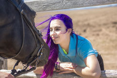 Beautiful teen girl on the farm with her horse. Stock Photos